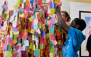 ArtPrize 2011 visitors hanging Hope Cards on Healing Tree